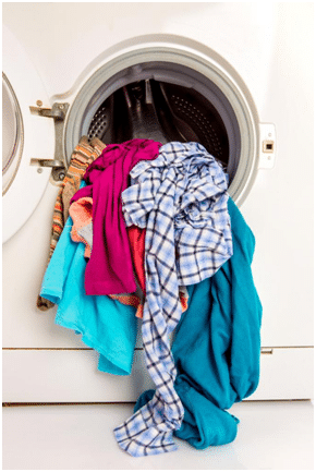 washing machine with dirty cloth in it, 5 Washing Machine Problems Most Homeowners Are Tired Of