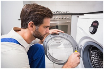 an appliance repair expert checking out a front load washing machine, Quick Front Load Washing Machine Maintenance Tips to Make It Last Longer